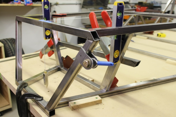 Chassis members clamped into place in preparation for tack welding.